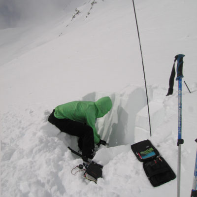 Digging a test profile during a ski tour