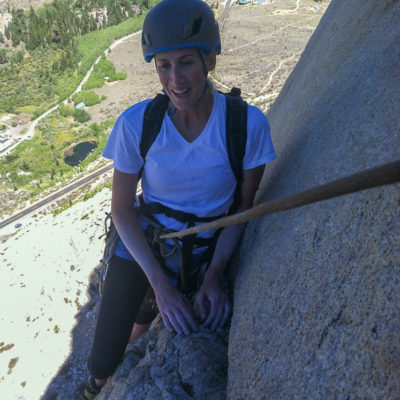 Emily G. collects herself after pulling the crux of West Face on Cardinal Pinnacle.