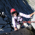 Frances C. loving the climbing on the North Ridge of Mt. Conness
