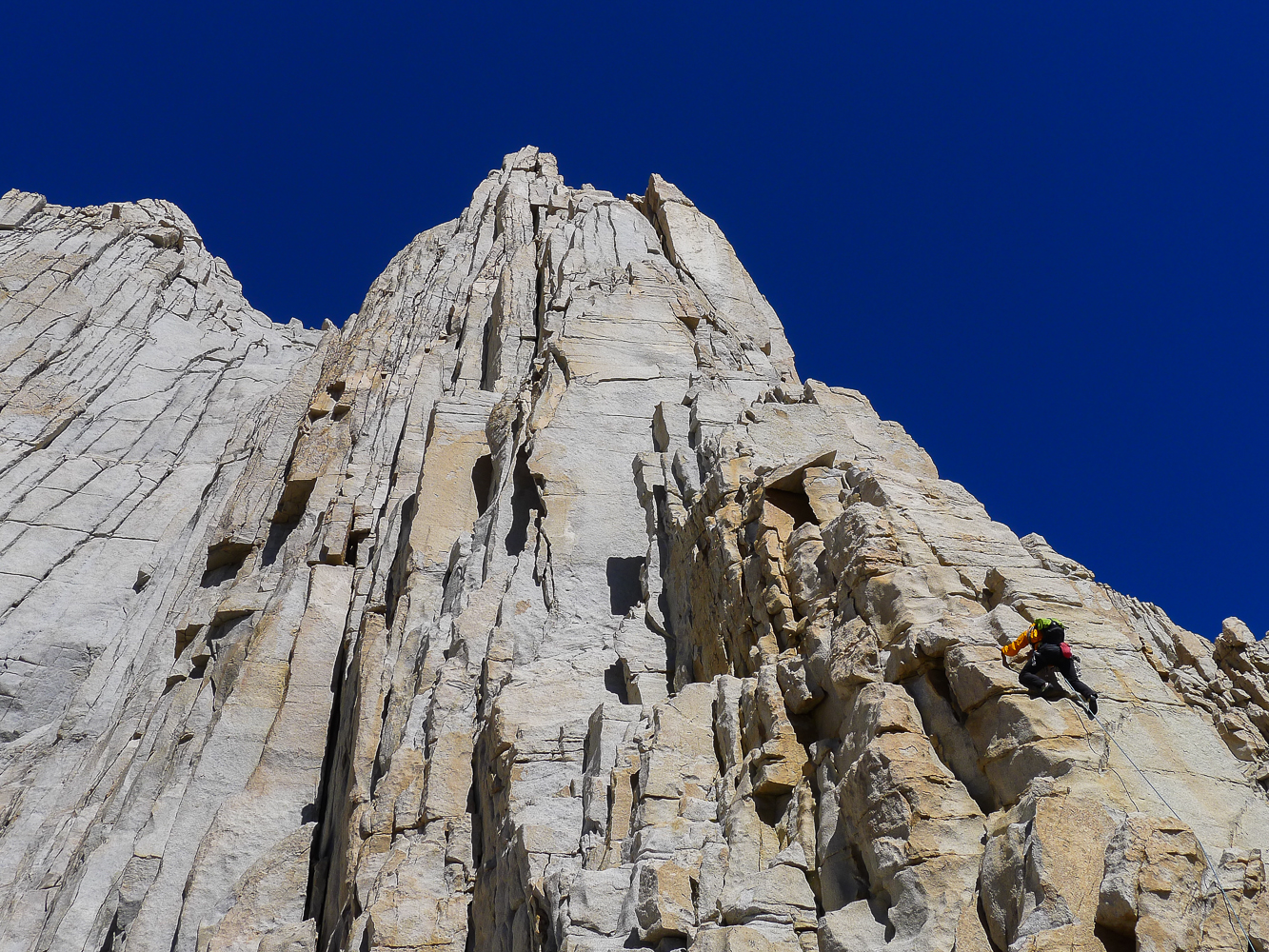 Peter Croft in the midst of guiding the Fishhook Arête in a day,