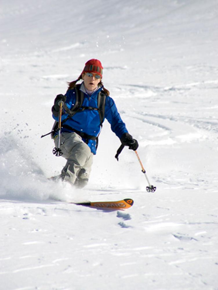 Woman telemark skiing. South Fork of Big Pine Creek. Sierra Nevada, CA